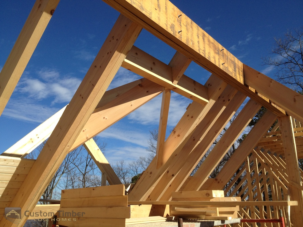 Heavy timber roof structure coming together. This area will be exposed ...